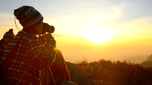nature photographer on the top of mountain - photographer stock videos & royalty-free footage