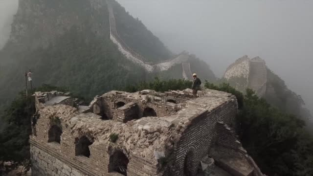 nature time neglect and millions of footsteps have taken their toll on the great wall of china leaving much of it crumbling but repairing it can be... - great wall of china stock videos & royalty-free footage