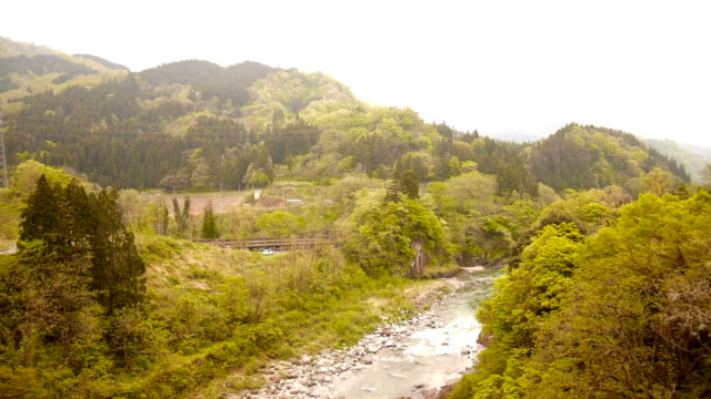 nature view tourist train to japan alps - tourist train stock videos and b-roll footage