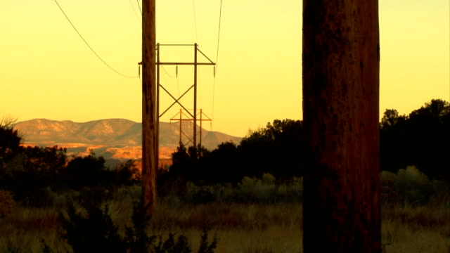 nature vs.technology - powerlines & mountains - power supply stock videos & royalty-free footage
