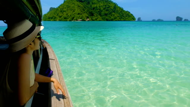 Nature-scape Cinemagraphs: Asian woman traveler on Thai boat