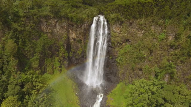 nature-scape cinemagraphs, karuru waterfall with rainbow - land stock videos & royalty-free footage