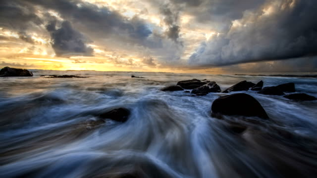 nature-scape cinemagraphs - sunset by the beach, norway - stavanger stock videos & royalty-free footage