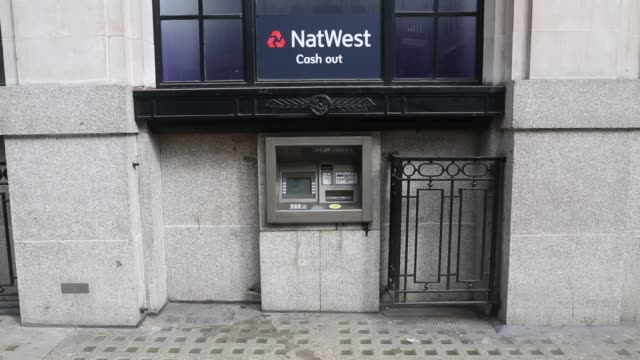 A NatWest sign for Cash Out sits above an automated teller machine operated by NatWest bank part of the Royal Bank of Scotland Group Plc in London A...