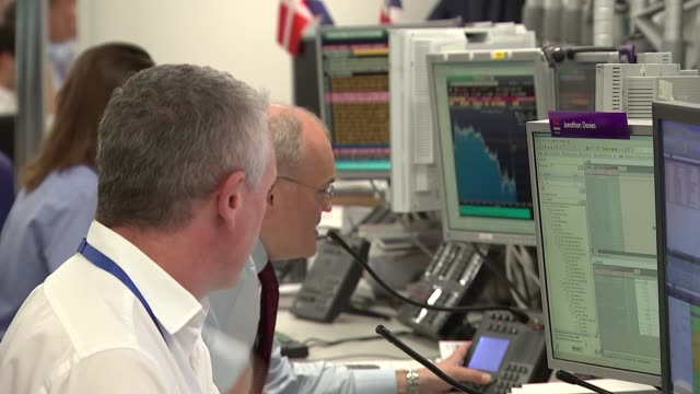 natwest traders' office general views england london int traders working in natwest office at desks with computers and monitors and chatting on... - market trader stock videos & royalty-free footage