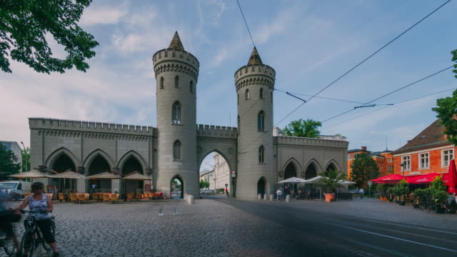 nauen gate in potsdam, with passing tram and people - time lapse - potsdam brandenburg stock videos & royalty-free footage