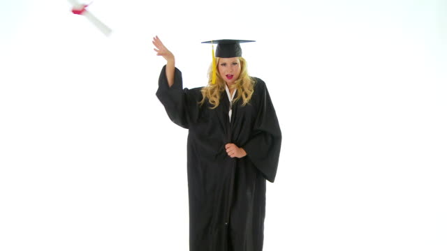 Naughty schoolgirl underneath the graduation gown