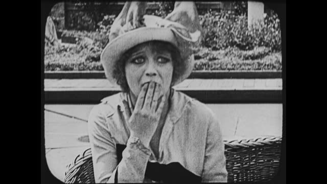 1917 nauseous woman on witching waves ride at coney island begins to feel very sick - brechreiz stock-videos und b-roll-filmmaterial