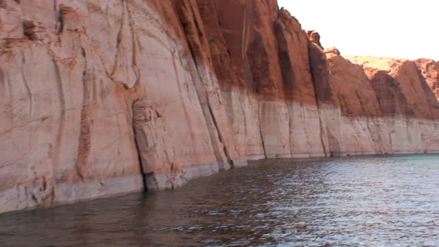 navaho sandstone cliffs - lake powell stock videos and b-roll footage