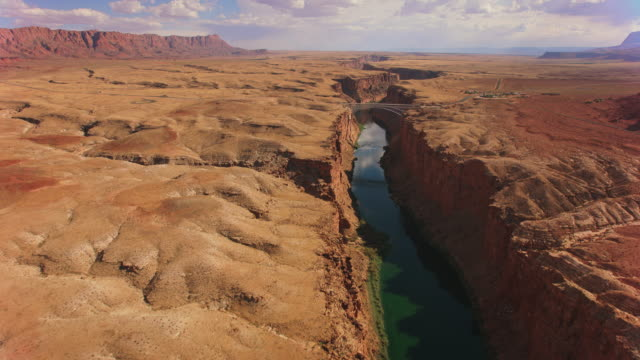 aerial navajo bridge over colorado river - river colorado stock videos & royalty-free footage