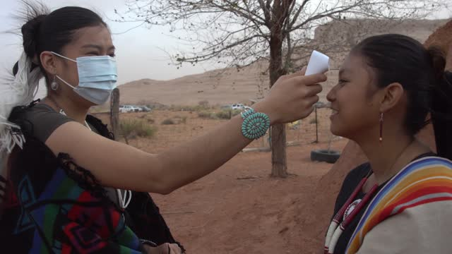 navajo girl getting her temperature taken during the covid-19 pandemic - indigenous north american culture stock videos & royalty-free footage
