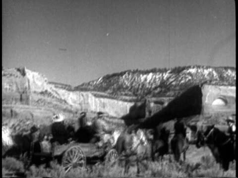 1939 montage navajo indian families arriving at reservation for traditional ceremony / southwest united states / audio - native american reservation stock videos & royalty-free footage
