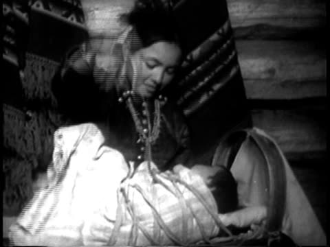1939 ms navajo indian mother cuddling her baby / southwest united states / audio - navajo culture stock videos & royalty-free footage