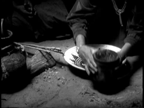 1939 MS Navajo Indian women preparing traditional mush in Navajo hogan / Southwest United States / AUDIO