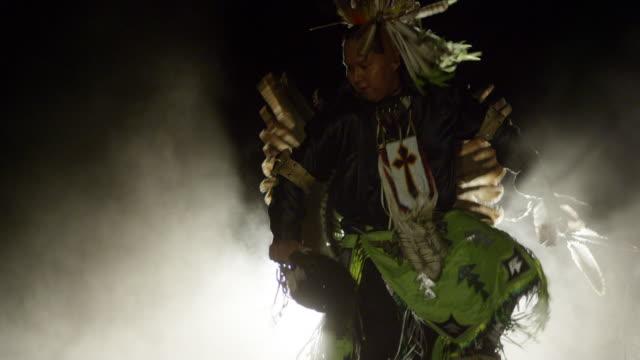 a navajo man dances in traditional dress - navajo culture stock videos & royalty-free footage