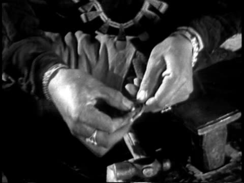 1939 cu navajo man making traditional necklace / southwest united states / audio - north american tribal culture stock videos & royalty-free footage