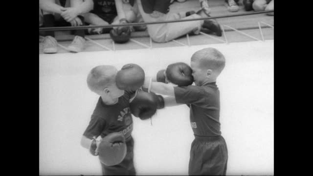 ext naval academy the day they host a children's boxing tournament / int peewee boxers line up for a weigh in / parents watch from the bleachers / cu... - boxhandschuh stock-videos und b-roll-filmmaterial