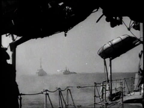 naval armada / view from side of ship, naval guns firing / troops wading to shore from amphibious landing craft / troops wading onto beach / soldier... - d day stock videos & royalty-free footage