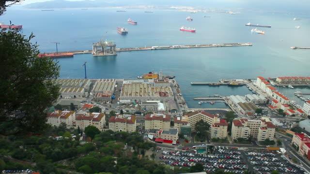 vídeos de stock e filmes b-roll de naval base with harbour docks. - frente ao mar