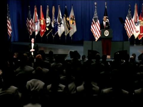 Naval cadets rise from their seats to congratulate President Barack Obama following his keynote speech putting forward new strategies for Afghanistan...