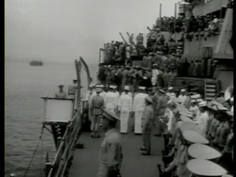 S Naval officers soldiers on crowded ship deck of USS Missouri MS Japanese Foreign Minister Mamoru Shigemitsu signing treaty September 2 1945 Tokyo...