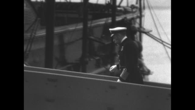 naval review by king george v to celebrate his silver jubilee / ws british navy ships at sea / king george v in naval uniform walking up gangplank of... - royal navy stock videos and b-roll footage