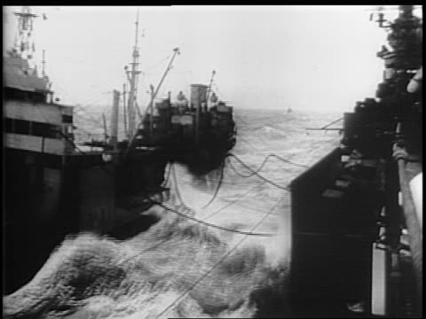 naval ships move toward tokyo in rough seas / montage of tanker refueling a battleship in stormy weather. - battleship stock videos & royalty-free footage