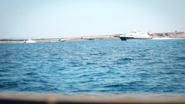 Navigating between Ibiza and Formentera with some boats passing by near the Island