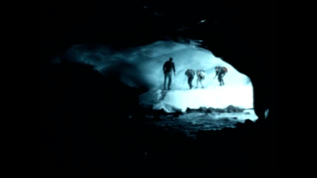 navigating the paradise ice caves in paradise glacier on the south eastern flank of mount rainier. the glacier dissipated in the 1990's due to... - mt rainier stock videos & royalty-free footage