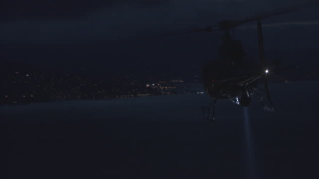 aerial navigation lights flashing on helicopter flying and hovering over nighttime city / san francisco, california, united states - ヘリコプター点の映像素材/bロール