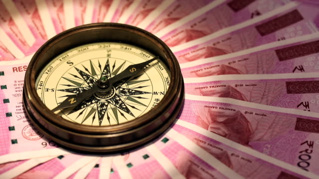 Navigational compass on indian two thousand banknotes