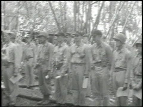 navy admiral chester nimitz pinning uncommon valor medal of honor [battle of bloody ridge] on colonel merritt edson 1st marine corps raider battalion... - ピンを刺す点の映像素材/bロール