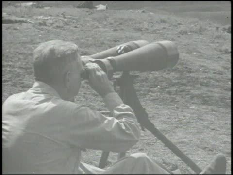 navy admiral william 'bull' halsey jr looking through japanese navy wide angle binoculars mounted on tripod commander of pacific fleet admiral... - william halsey stock-videos und b-roll-filmmaterial