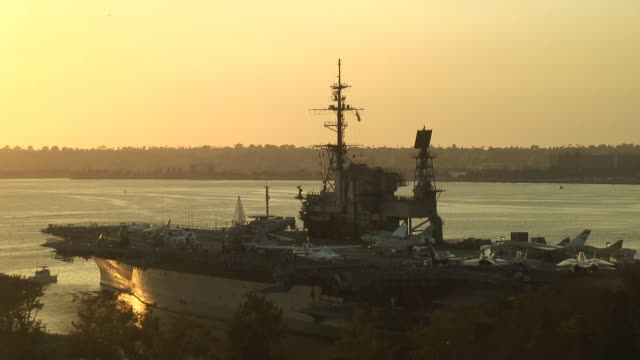 (hd1080i) navy aircraft carrier deck at sunset - us military stock videos & royalty-free footage