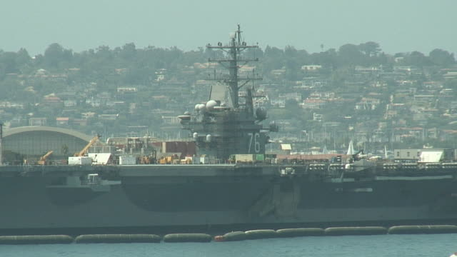 (hd1080i) navy aircraft carrier docked in san diego - persuasion stock videos and b-roll footage