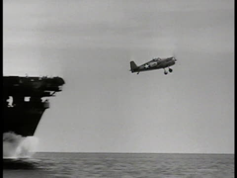 navy aircraft carrier on ocean. grumman 'hellcat' fighter taking off. hellcats' on carrier deck. fighter taking off. sailors looking skyward. fighter... - d day stock videos & royalty-free footage