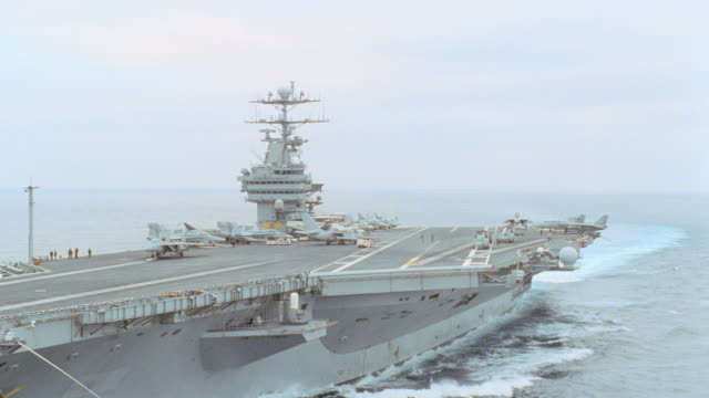 a u.s. navy aircraft carrier travels on the ocean. - us navy stock videos & royalty-free footage