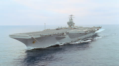 a u.s. navy aircraft carrier travels on the ocean. - warship stock videos & royalty-free footage
