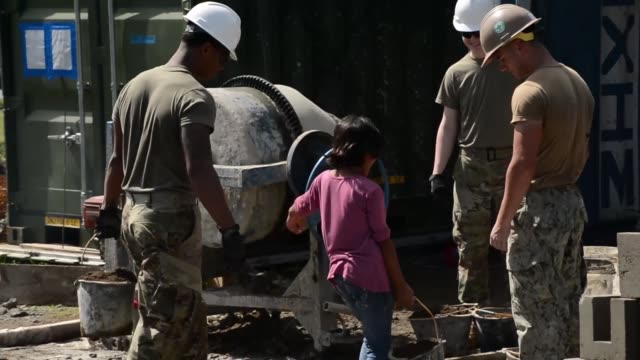 navy, army and air force civil engineers work together to build an addition to an indonesian school during pacific partnership 2018 in bengkulu... - school child stock videos & royalty-free footage