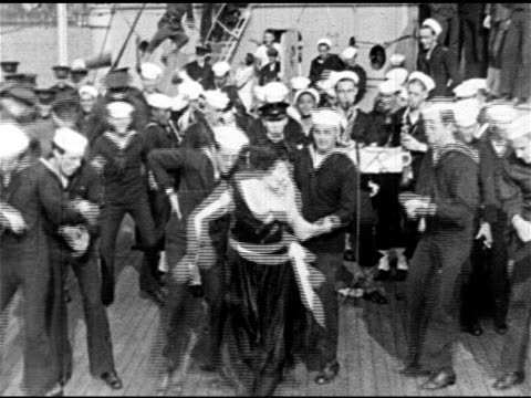 navy battleship moored in harbor, female dancer dancing 'black bottom' dance w/ u.s. sailors on deck, sailor's legs dancing dance steps next to... - us navy stock videos & royalty-free footage