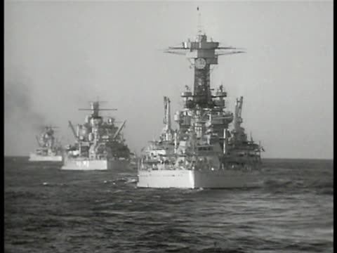 Navy Battleships on ocean Officers on watch distant airplanes flying sailor reporting to commanding officer ship's Captain More Battleships...