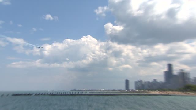 navy blue angels fly over chicago's lakefront ahead of the 2014 air and water show on aug. 16, 2014. - chicago air and water show stock videos & royalty-free footage