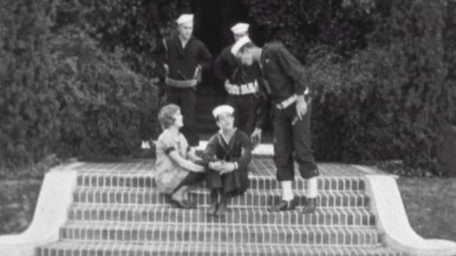 navy blues silent short / a naval recruit kisses his love / naval crew finds out he is missing / naval buddies trip him and haul him off / you can't... - 1923 stock videos & royalty-free footage