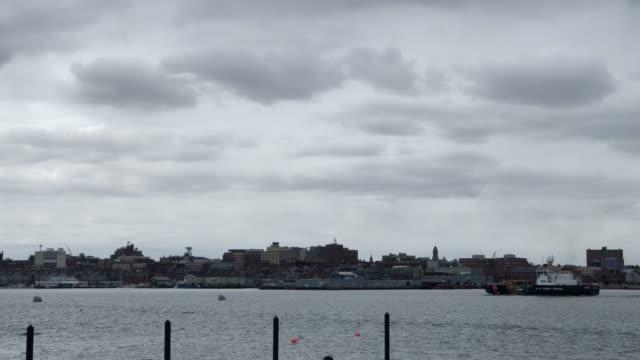 usa navy coast guard ship pulls into portland, harbor during springtime in portland, maine usa - maine stock videos & royalty-free footage