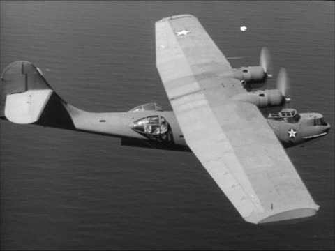 navy consolidated pby-5 catalina airplane. dramatization: port gunner calling pilot pilot answering. aerial us navy consolidated pby-5 catalina... - air vehicle stock-videos und b-roll-filmmaterial