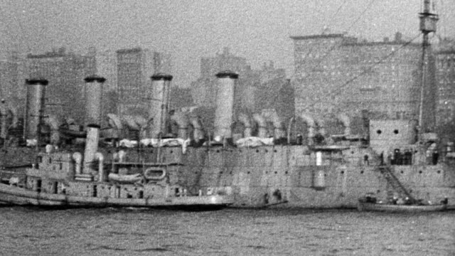 navy cruiser ship and ocean liners in new york harbor downtown building skyline in background - new york harbor stock videos & royalty-free footage