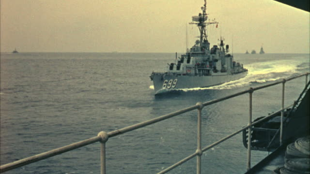 1967 MS Navy destroyer approaching another military ship