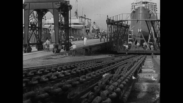 s navy destroyer battle ship in dock port cranes trucks int cu large gear turning ship in drydock through window bg ext cu chains pulling ship in dry... - 1937 stock videos and b-roll footage