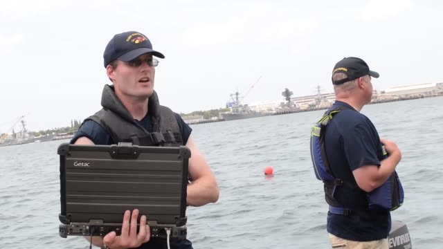 us navy divers carry out an underwater survey and inspection of the uss arizona memorial by navy personnel during rim of the pacific exercise - us navy stock videos & royalty-free footage