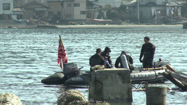 Navy divers search for bodies in Kessenuma city port, Japan filmed on 1 April 2011, 3 weeks after a tsunami which was caused by magnitude 9 Tohoku earthquake off north east Japan / AUDIO